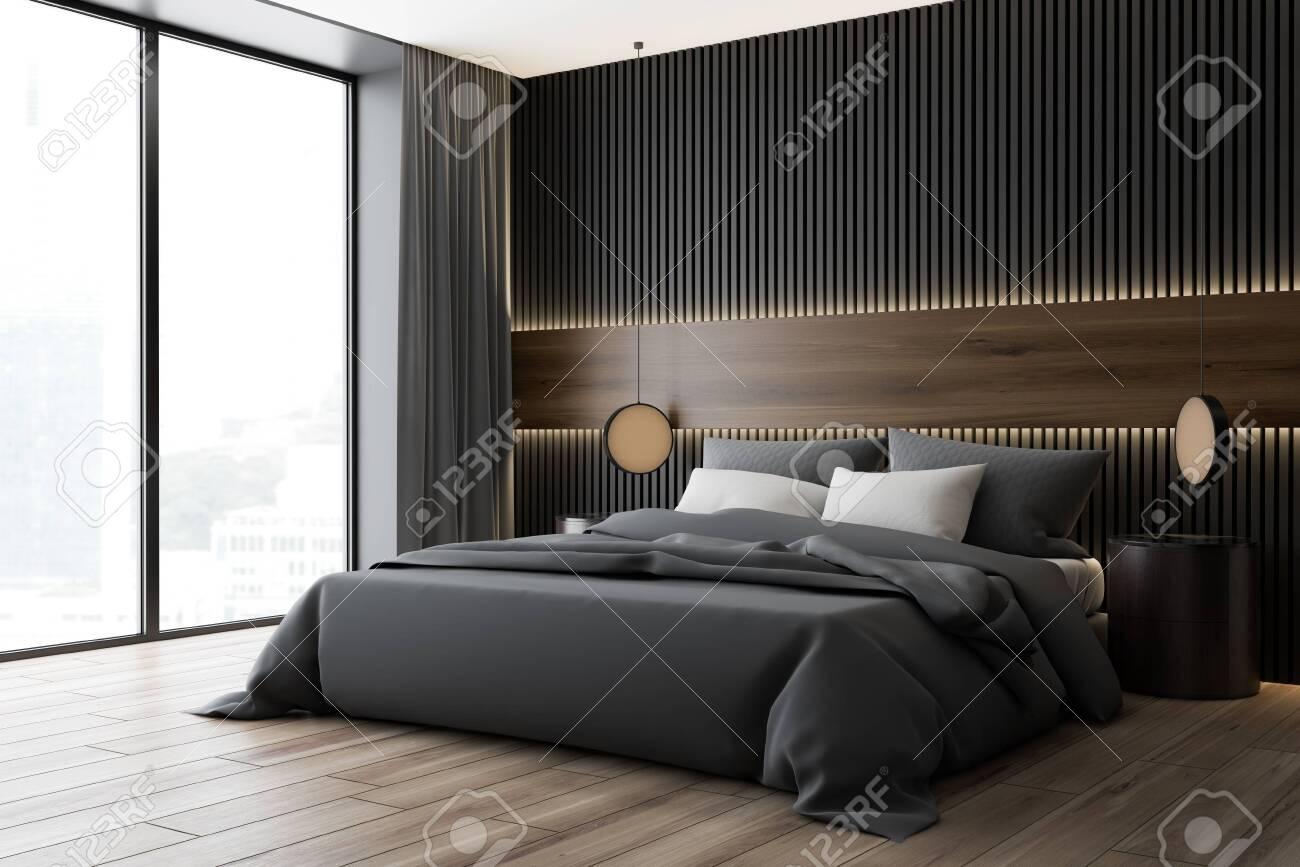 corner of modern bedroom with dark wood and gray walls wooden