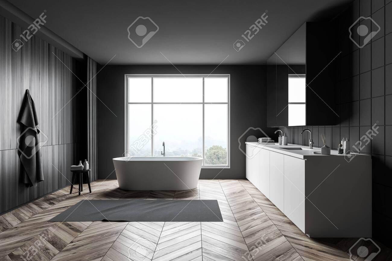 front view of minimalist bathroom with gray tile and dark wooden