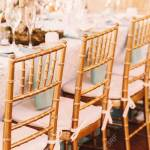 Chairs Made Of Bamboo Stand At The Blue Dinner Table