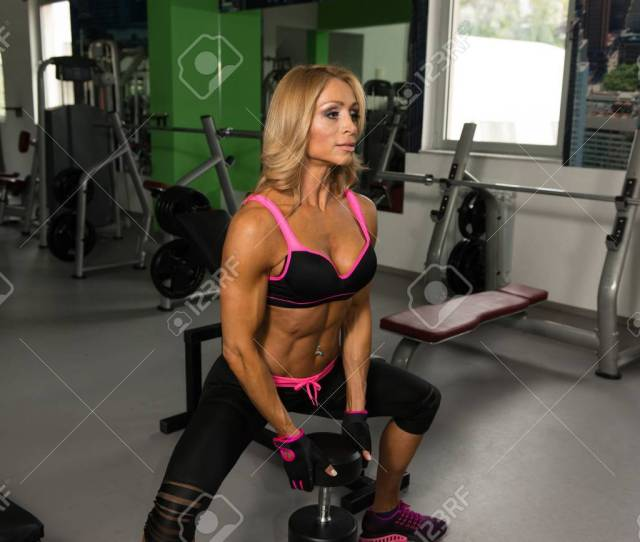 Mature Fitness Woman Working Out Ass In Fitness Center Stock Photo 68306545