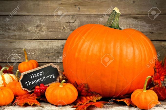 Autumn Pumpkins With Happy Thanksgiving Chalkboard Tag Against