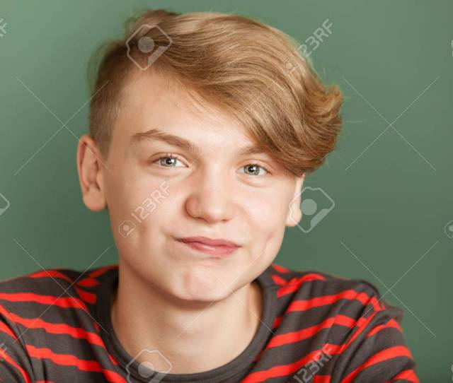 Close Up Portrait Of Blond Teenager In Stripped T Shirt Looking At Camera With