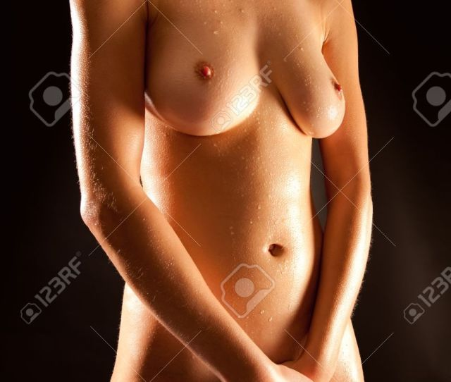 Closeup Of A Beautiful Nude Female Body In Front Of Black Background Stock Photo 9832886