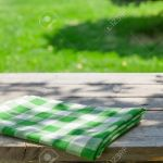 Empty Wooden Garden Table With Tablecloth With Green Bokeh Background Stock Photo Picture And Royalty Free Image Image 43114929