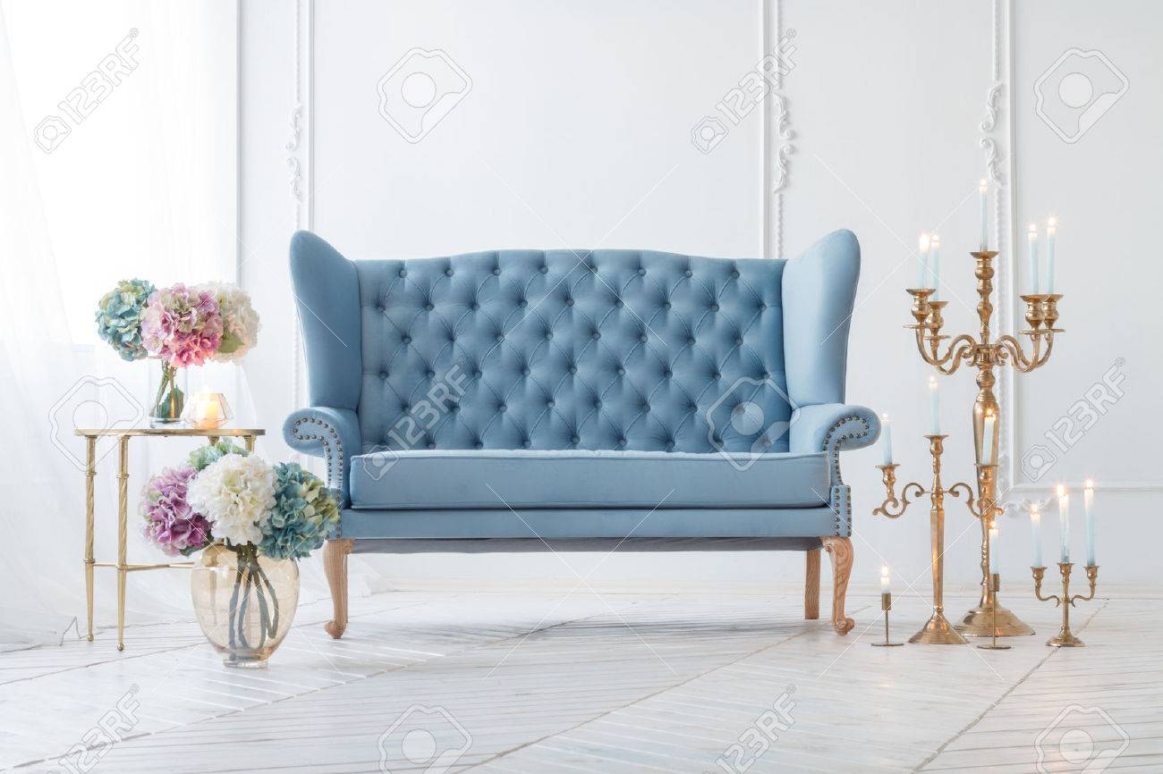 Beautiful Provance Living Room With Blue Sofa Near Table With     Beautiful Provance Living Room With Blue Sofa Near Table With Flowers And  Candles Stock Photo