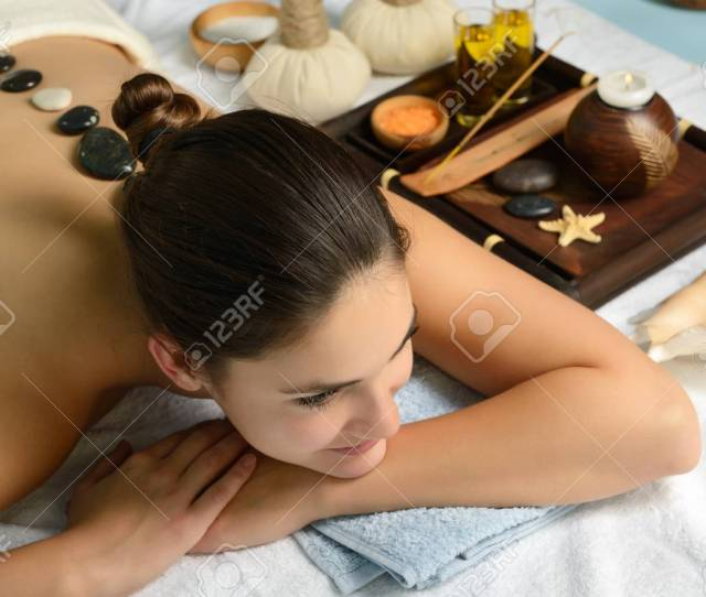 Stock Photo Young Beautiful Woman In Spa Environment Gets Massage With Hot Stones Salon Stone Therapy