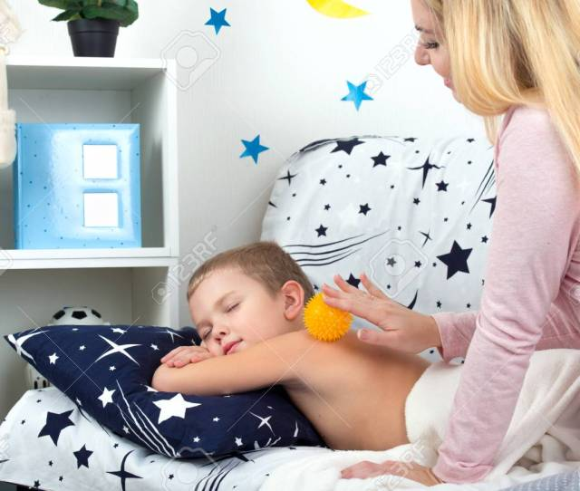 Stock Photo The Mother Makes The Massage Of The Back Of His Little Son