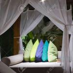 Big Outdoor Bed Under Bed Curtains With Bright Color Pillows Stock Photo Picture And Royalty Free Image Image 87426161