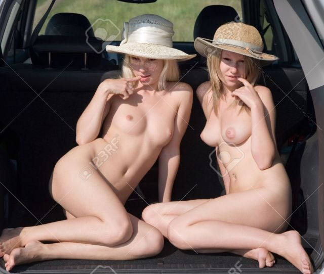 Stock Photo Two Young Nude Girls Sitting In The Car