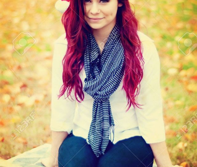 Beautiful Red Head Teen Girl With Santa Hat Sitting On Bench Stock Photo 16573864