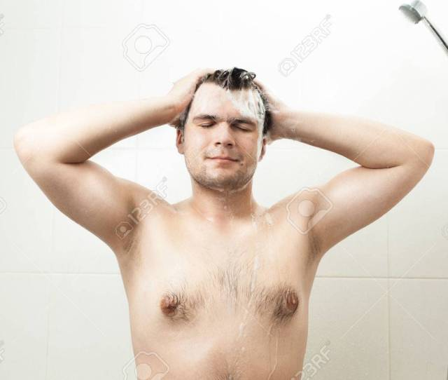 Portrait Of Sexy Smiling Man Washing Hair At Shower Stock Photo 33901534