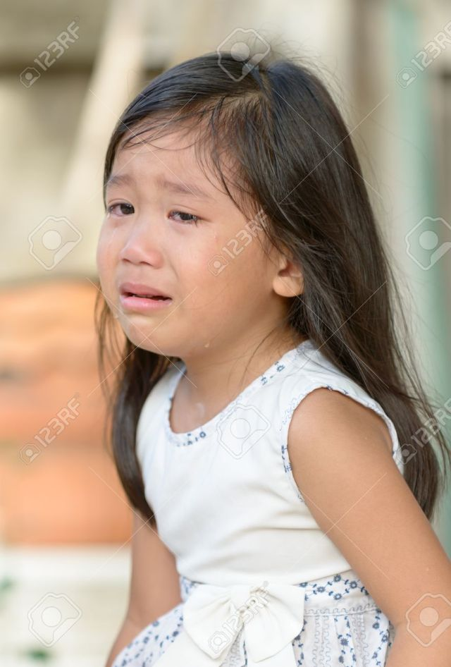 Cute Little Asian Girl Crying At Home Stock Photo 41128000