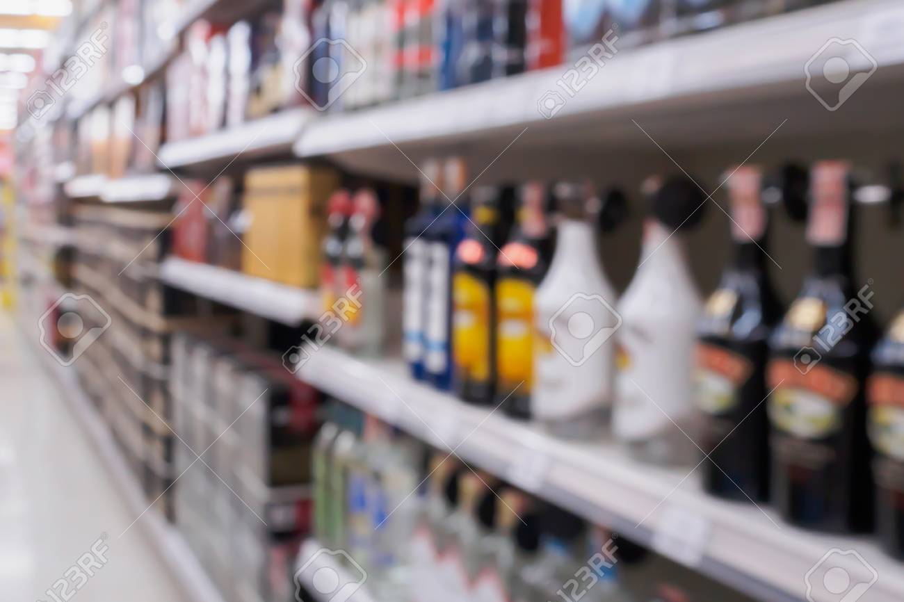 Wine Liquor Bottles And Alcohol Beverage Shelves In Supermarket