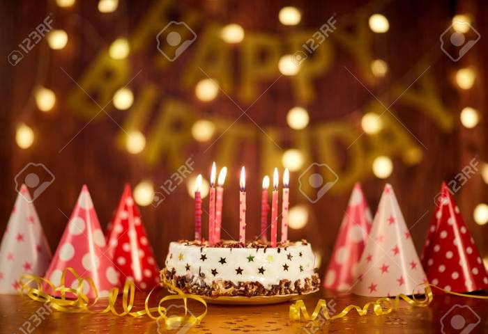 Happy Birthday Cake With Candles On The Background Of Garlands