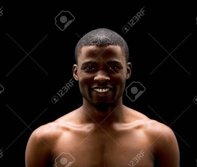 Portrait Of Handsome Naked Black Man Posing Over Black Background In Studio Short Haired Afro
