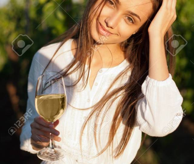Portrait Of A Gorgeous Brunette Woman Having Wine Fun In The Vineyards Stock Photo