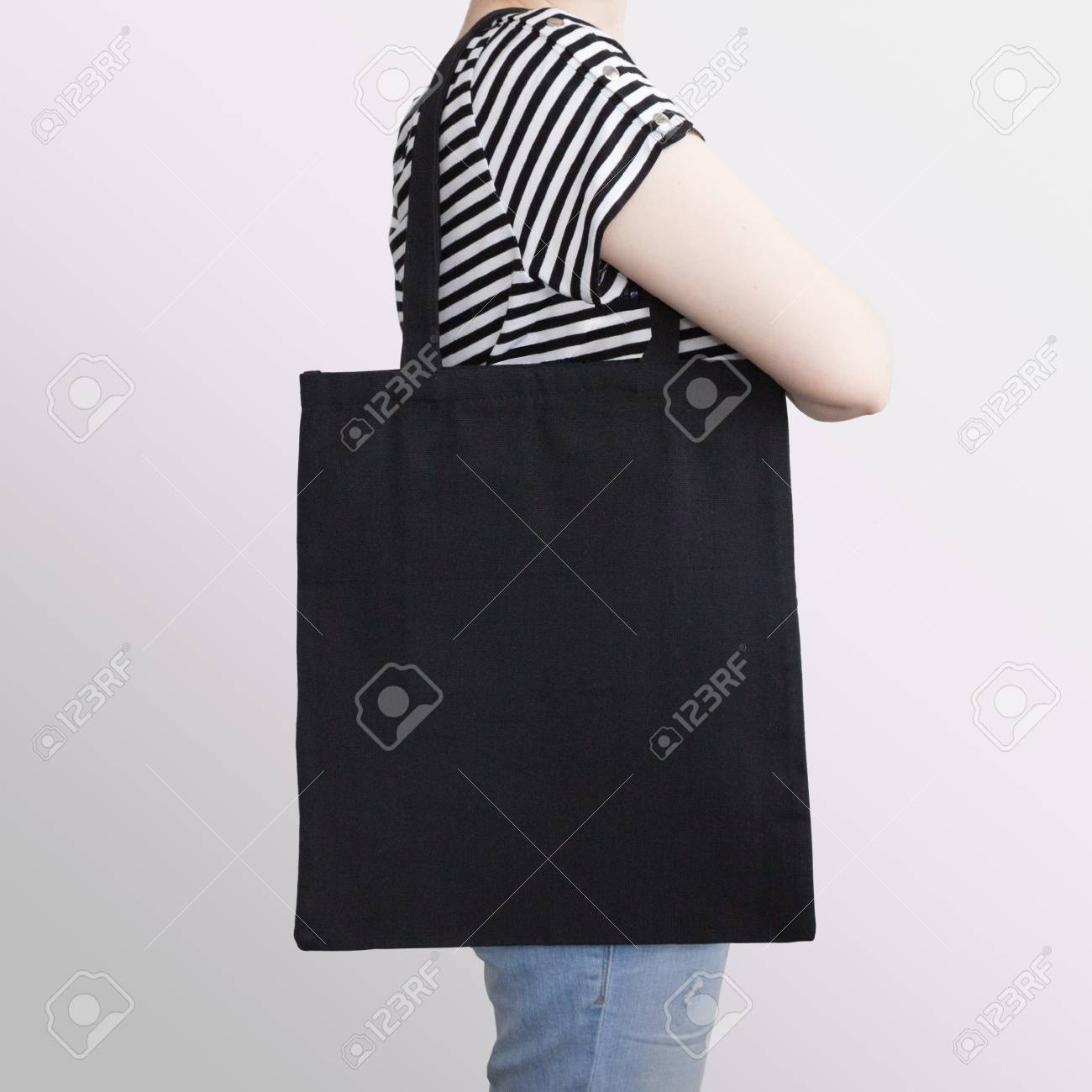 These tote bag mockups will save you time, money and. Girl Is Holding Black Cotton Eco Tote Bag Design Mockup Stock Photo Picture And Royalty Free Image Image 100702875
