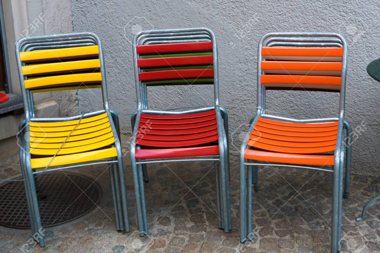 colorful garden patio chairs stacked on top of each other and stock photo picture and royalty free image image 122215118