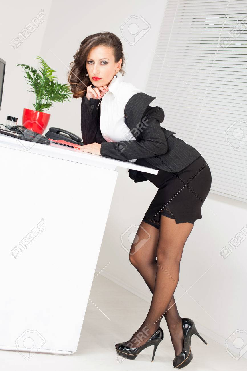 Sexy Business Woman Standing And Leaning On The Office Table Stock Photo 27412981