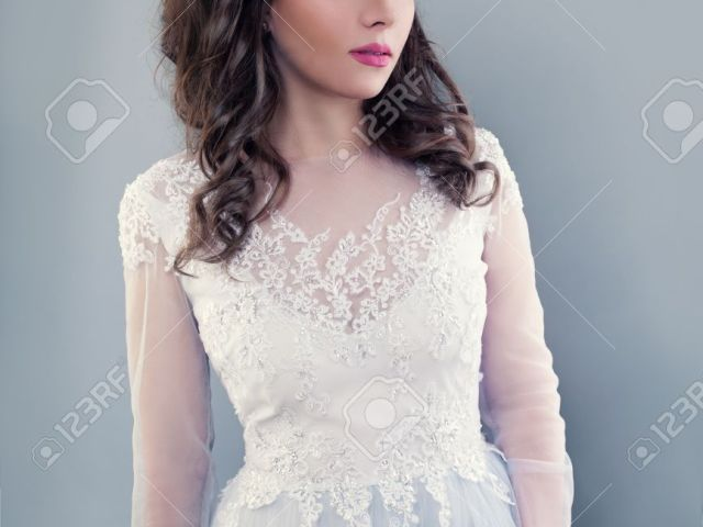beautiful young woman wearing evening gown. perfect bride with