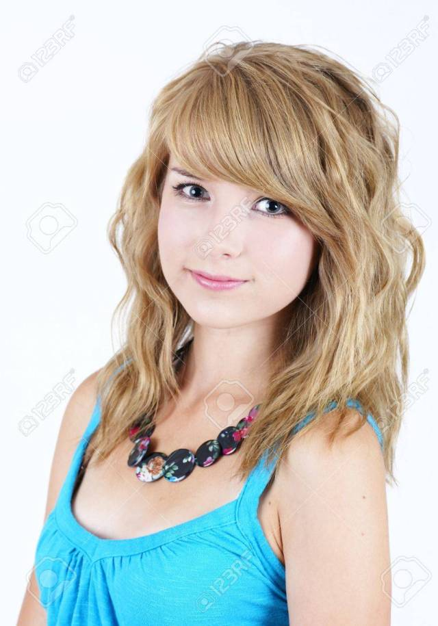 Portrait Of A Pretty Young Blond Teenager Girl Smiling Looking At Camera Stock Photo