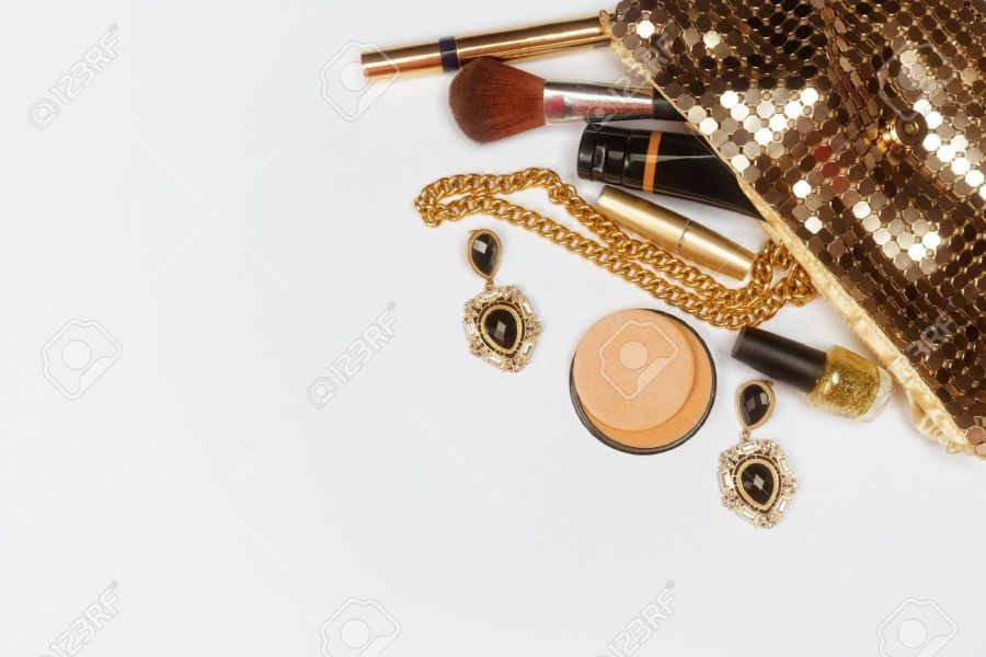 Golden Woman Accessories  Make Up Pieces  Jewelry And Shiny Purse     Golden woman accessories  Make up pieces  jewelry and shiny purse  Top view