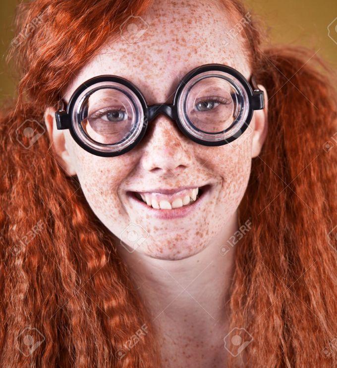 cheerful freckled nerdy girl