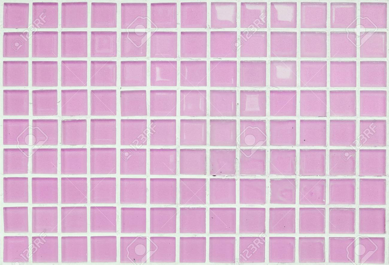 closeup surface of pink glass tile at the temple wall texture