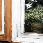 Bouquet Of Wild Flowers In A Wicker Basket On A Rustic Window
