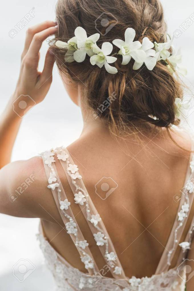 bride hairstyle closeup, view from the back, wreath of orchids