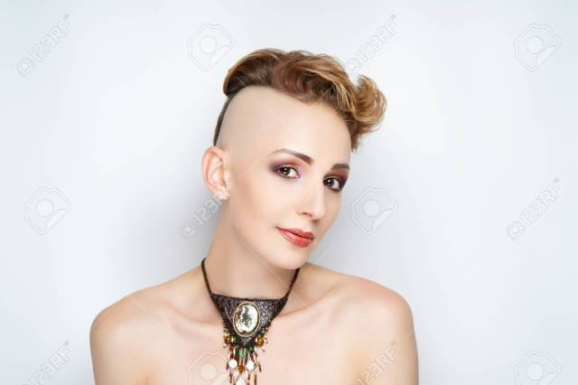 beautiful face girl with a short haircut and a shaven temple