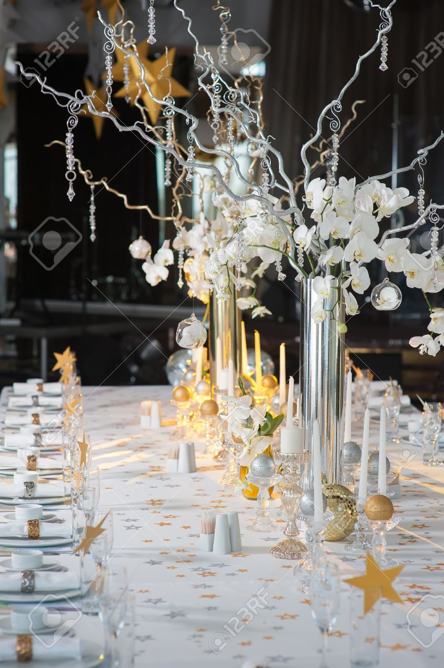 https www 123rf com photo 53403260 the branches of orchids in vases on the holiday table decorative branch with crystal elements decora html