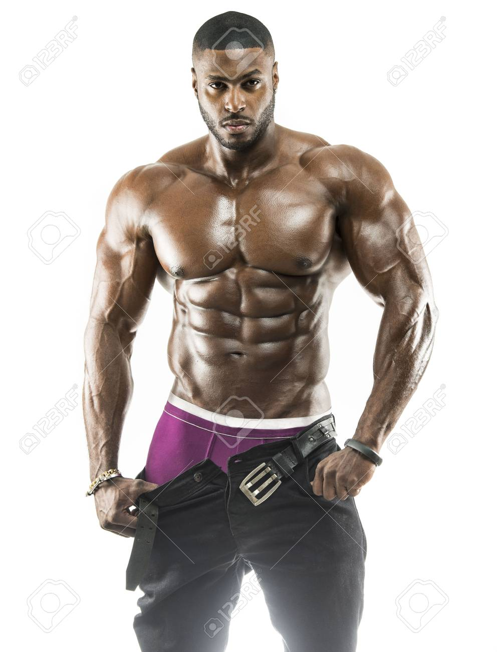 Handsome Muscular Arabic Black Man Removing His Pants Showing Abs And Black Under Wear With Oiled