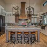 Large Pendant Lights Hang Over A Marble Top Kitchen Island Stock Photo Picture And Royalty Free Image Image 144581282