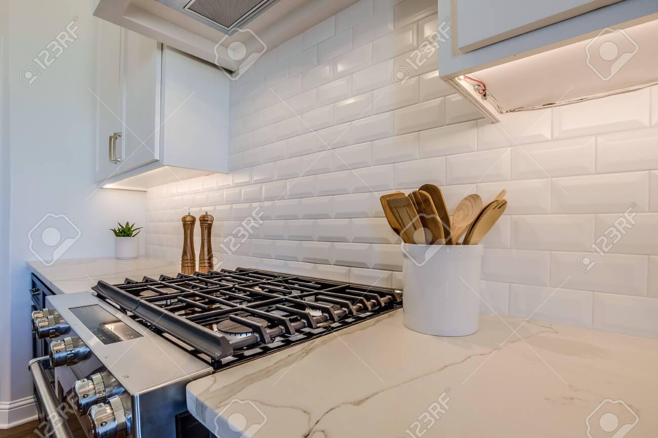 magnificent cooktop area and white tile backsplash