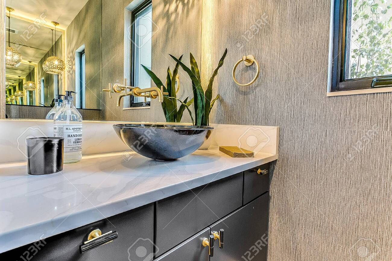 stunning bathroom with vessel sink and wall mounted faucet