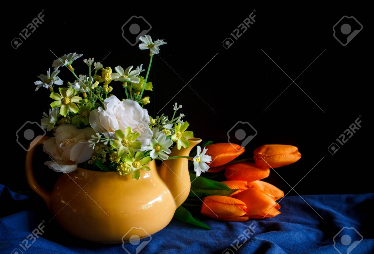 Flower In A Yellow Tea Pot And Orange Tulip Cozy Home Rustic