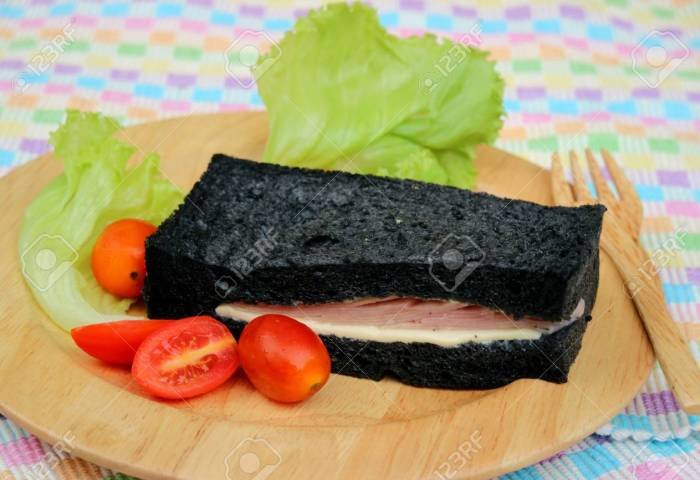 Black Bread Sandwich On Wooden Plates Stock Photo Picture And