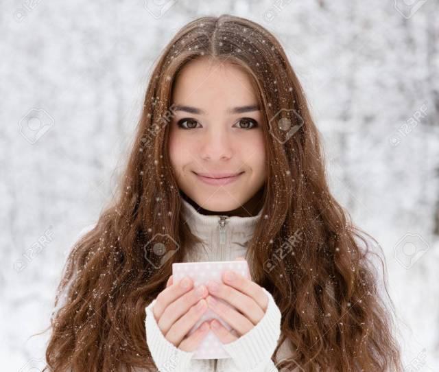 Stock Photo Teen Girl Enjoying Big Mug Of Hot Drink During Cold Day