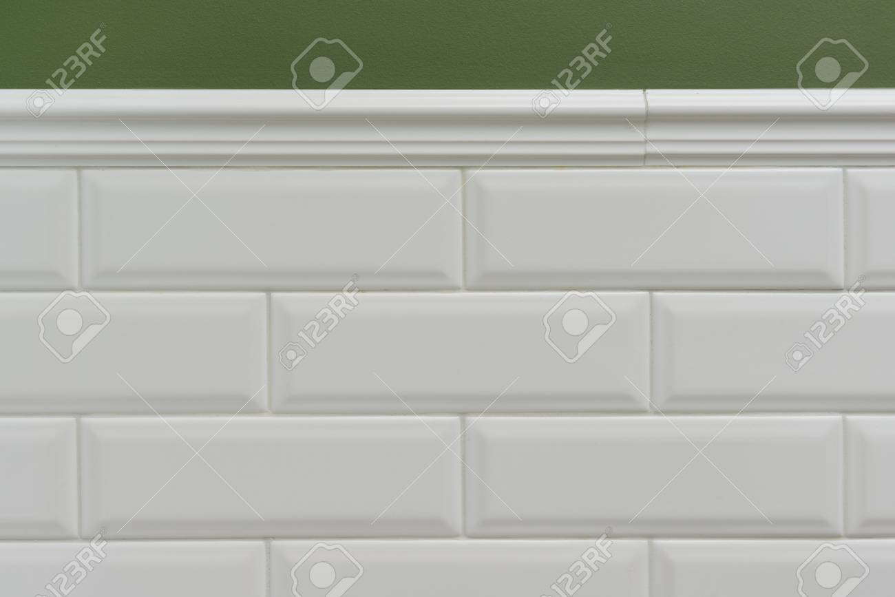 green painted wall part of the wall is covered tiles small white stock photo picture and royalty free image image 104506455