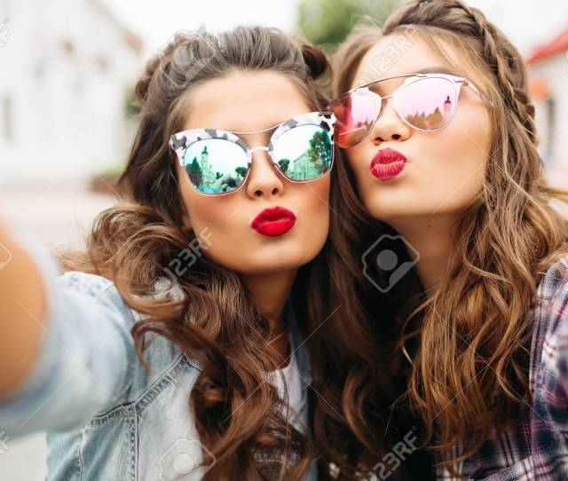 Gorgeous Brunette Girlfriends With Hairstyle Mirrored Sunglasses And Red Lips Making Selfie With Duck Face