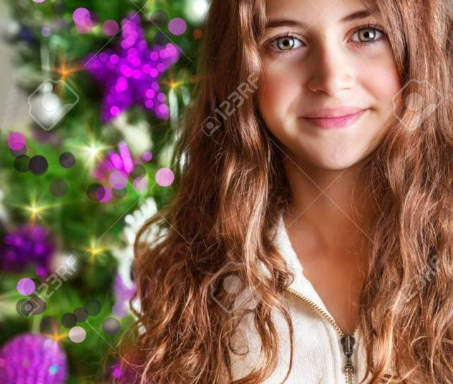 Closeup Portrait Of Sweet Teen Girl On Christmas Tree New Year Children Party Happy