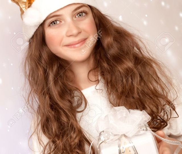 Closeup Portrait Of Cute Little Santa Helper Sweet Teen Girl With White Wrapping Gift Box