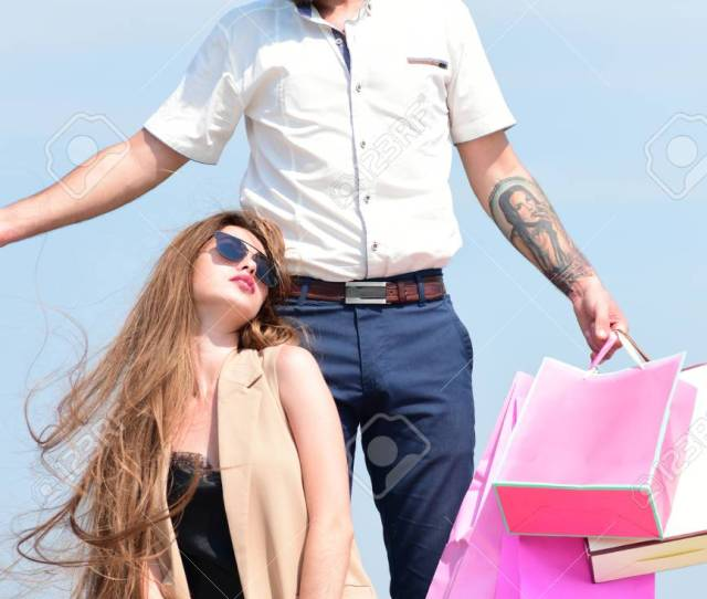 Macho Carries Pink Packets On Blue Sky Background Sexy Girl Sits By Bearded Guy With