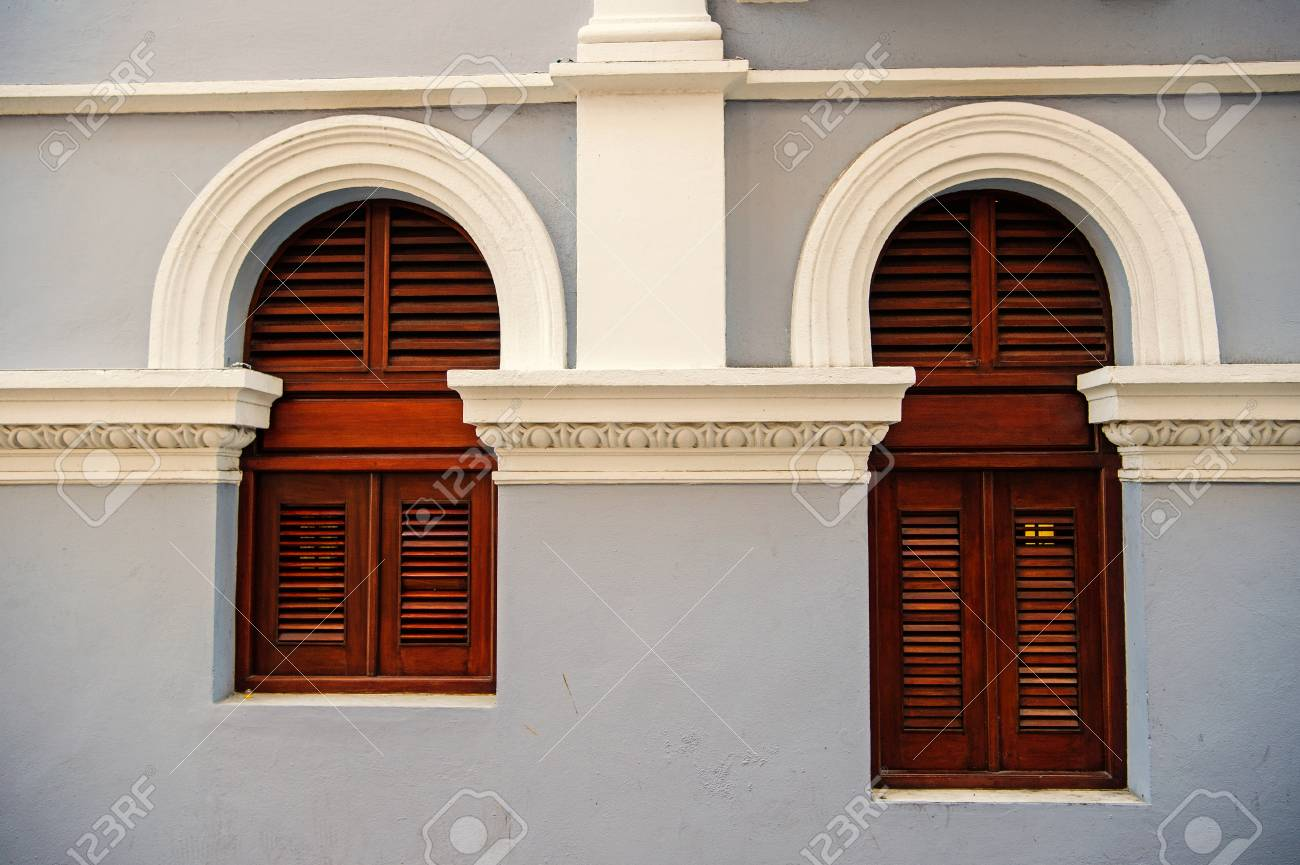 Big And Small With Wooden Shutters On Grey Wall
