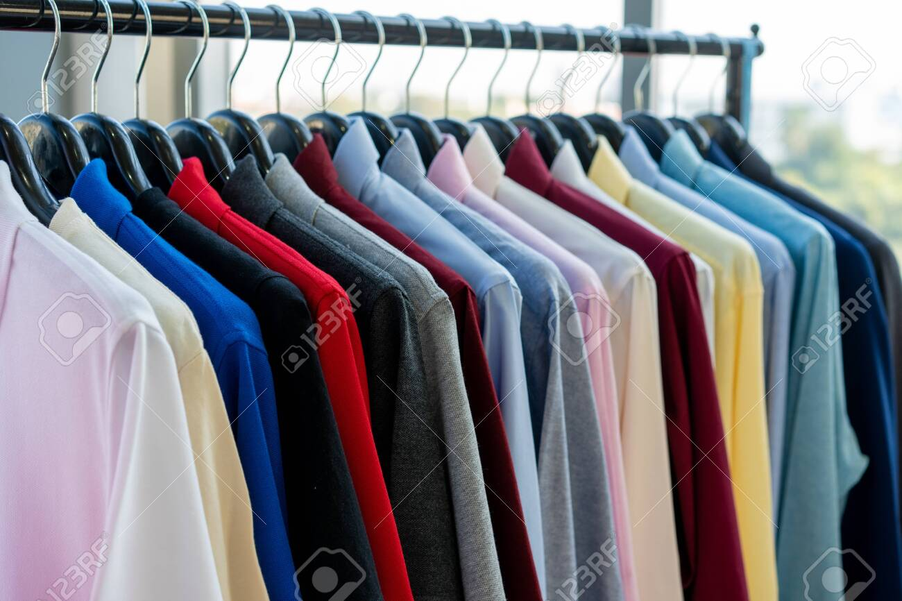 clothes hang on a shelf in a designer clothes store clothes stock photo picture and royalty free image image 141349404