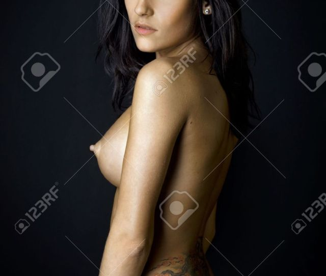 Back Of The Beautiful Naked Woman With Tattoo Photo With Dark