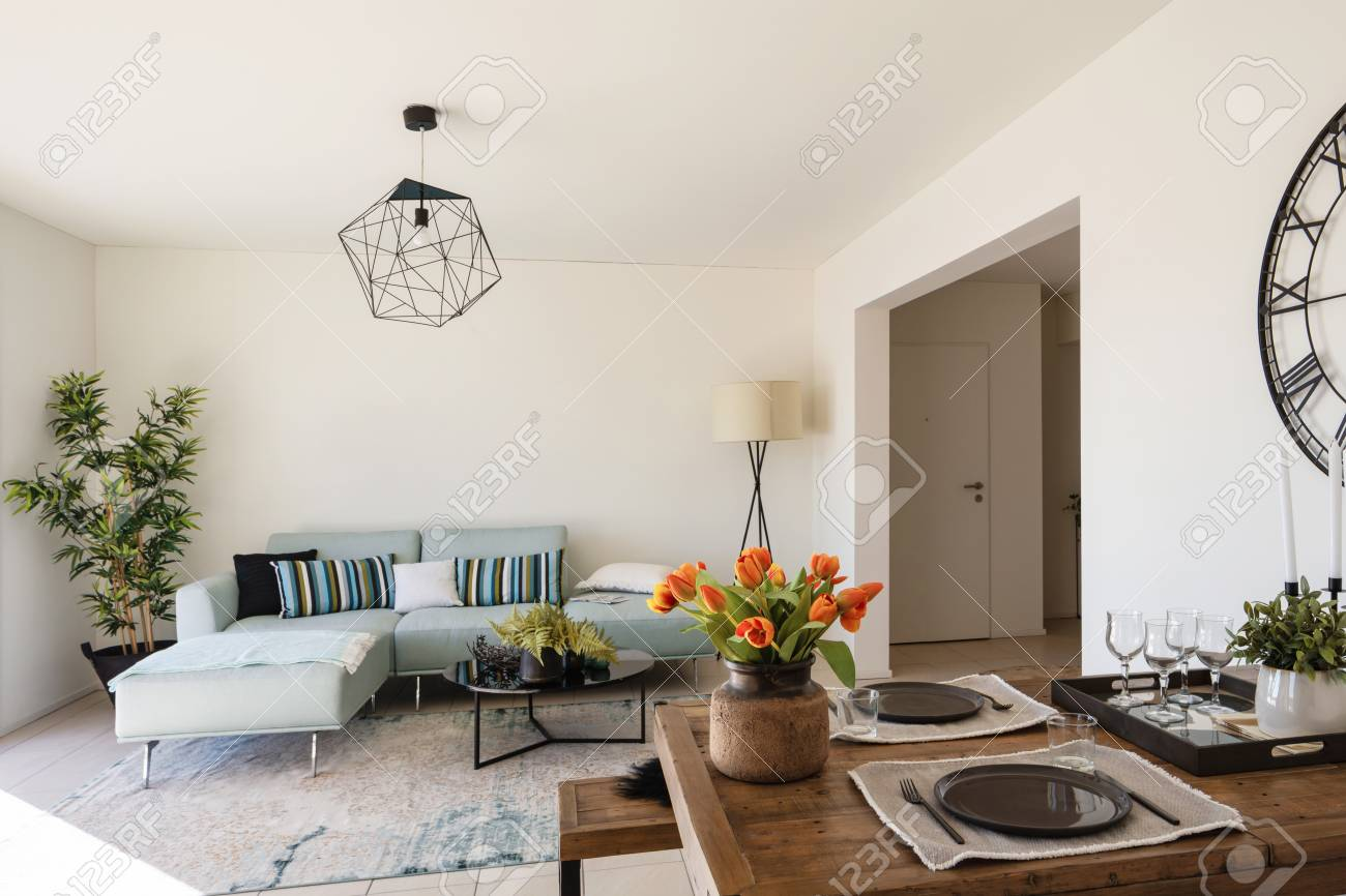 https www 123rf com photo 118204440 modern living room with designer sofa and coffee table wooden table set with plates and cutlery nobo html