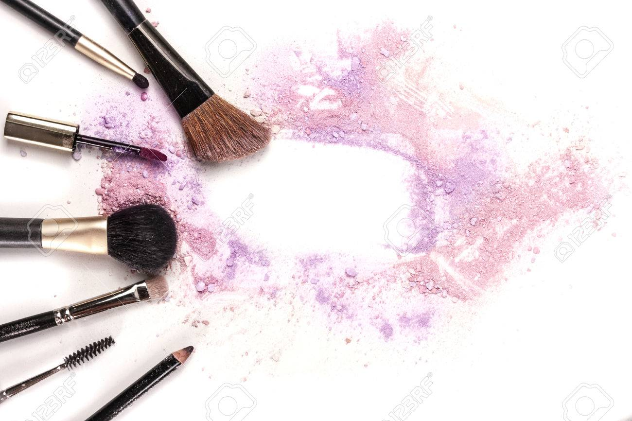 Makeup Brushes  Lip Gloss And Pencil On White Background  With     Makeup brushes  lip gloss and pencil on white background  with traces of  powder and