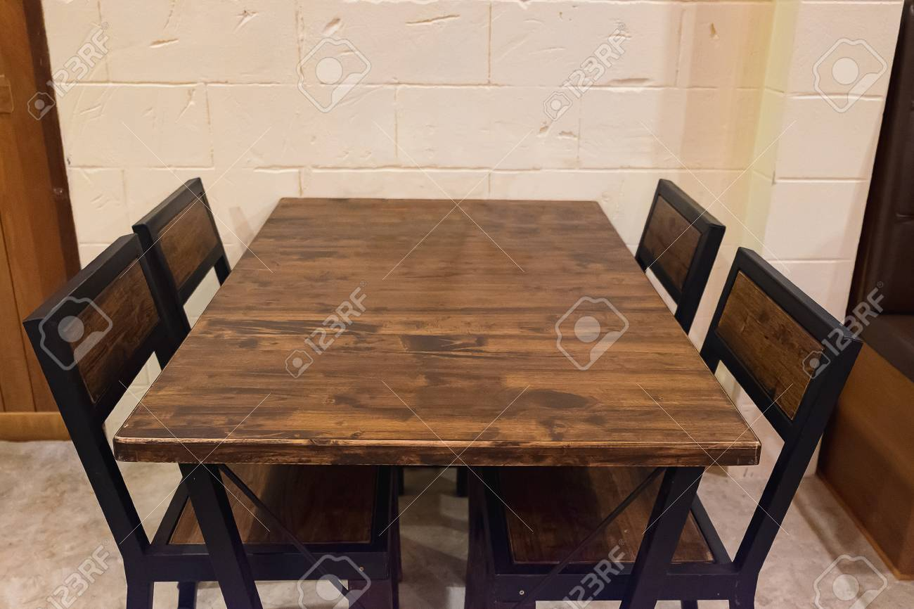 Oak Dining Table With Chairs In Dark Room Wooden And Black Metal Stock Photo Picture And Royalty Free Image Image 71574041